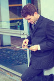 Businessman in suit using tablet PC Royalty Free Stock Photography