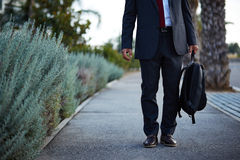 Businessman in a suit walking Stock Image