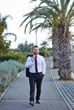 Businessman in a suit walking Royalty Free Stock Photos