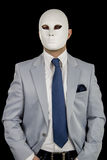 Businessman in suit wearing mask, business power Stock Images