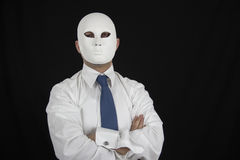 Businessman in suit wearing mask, business power Royalty Free Stock Photos