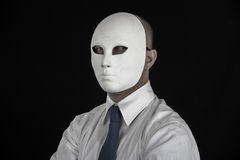 Businessman in suit wearing mask, business power Royalty Free Stock Photography