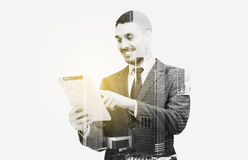 Businessman in suit working with tablet pc Royalty Free Stock Image