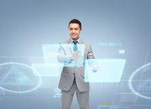 Businessman in suit working with virtual screens Stock Photos