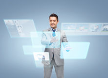 Businessman in suit working with virtual screens Royalty Free Stock Photos