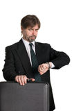 Businessman with suitcase Royalty Free Stock Photos