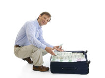 The businessman with a suitcase Royalty Free Stock Photos