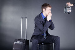 Businessman with suitcase and clock Stock Images