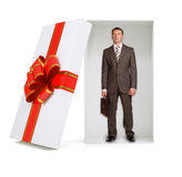 Businessman with suitcase in gift box on white Stock Image
