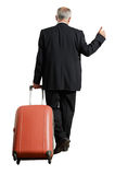 Businessman with suitcase is hiking Stock Photo