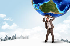 Businessman with suitcase holding earth Stock Images