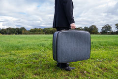 Businessman with suitcase Stock Images