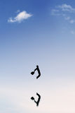 Businessman with suitcase leaps on the sky Royalty Free Stock Photography
