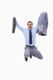 Businessman with suitcase in mid air Stock Photos