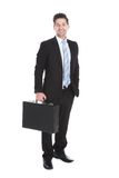 Businessman with suitcase over white background Stock Photography