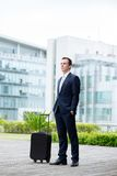 Businessman with a suitcase Stock Photos