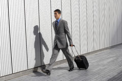Businessman With Suitcase Walking Outdoors Royalty Free Stock Photos