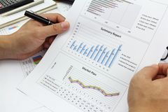 Businessman Summary report and  market plan . Businessman Summary report and  market plan analyzing order plan, pen and calculator on paperwork Royalty Free Stock Photos