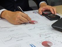 Businessman Summary report market plan finance. With calculate about cost at table office office Stock Photos