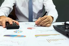 Businessman Summary report plan finance. Businessman Summary report plan finance with calculate about cost at table office office Stock Images
