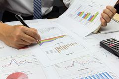 Businessman Summary report plan and financial analyzing product. Market plan, and Review accounting data and calculate order income Royalty Free Stock Image