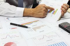 Businessman Summary report plan and financial analyzing product. Market plan, and Review accounting data and calculate order income Royalty Free Stock Photo