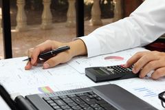 Businessman  summary report plan product. With calculate about market cost at table office office Royalty Free Stock Image