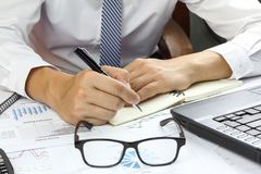 Businessman Summary report sell market plan finance. With calculate about cost at table office office Stock Photo