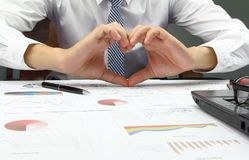 Businessman Summary report and show hand we love work office Stock Photography