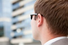 Businessman with sunglasses Stock Image