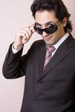 The businessman in sunglasses. Portrait of the businessman in a brown suit in sunglasses stock photos