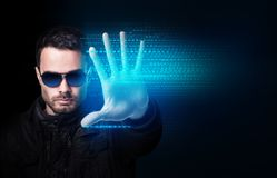 Businessman in sunglasses control virtual glowing computer code. stock photos