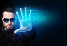 Businessman in sunglasses control virtual glowing computer code. Modern technologies concept royalty free stock photography