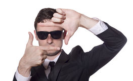 Businessman with sunglasses framing his face Royalty Free Stock Images