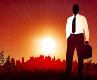 Businessman on sunset background with skyline Royalty Free Stock Photography