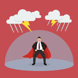 Businessman superhero with barrier protecting from thunderstorm Royalty Free Stock Photography