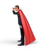 A businessman in a superhero cape and a mask looking in the distance in side view. Stock Photos