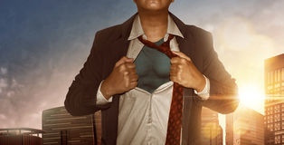 Businessman superhero. In city building at sunset Royalty Free Stock Images