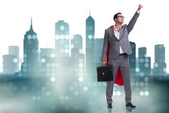 The businessman in superhero concept with red cover. Businessman in superhero concept with red cover stock photo