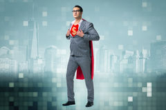 The businessman in superhero concept with red cover. Businessman in superhero concept with red cover stock photos