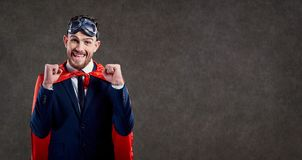 A businessman in a superhero costume is a winner. stock photography