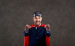 A businessman in a superhero costume is a winner. royalty free stock image