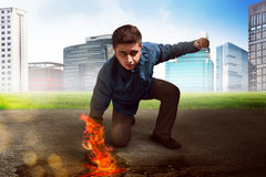 Businessman superhero. With fire punch Stock Photography