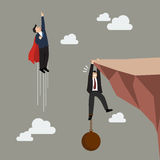 Businessman superhero fly pass businessman hold on the cliff with burden Royalty Free Stock Photography