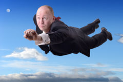 Businessman superhero. A businessman superhero flying to success royalty free stock photography