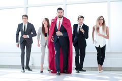 Businessman superhero and his business team are stepping togethe royalty free stock photos