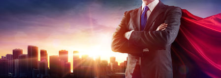 Businessman Superhero With Red Cape. Dominates The City stock photos