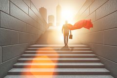 The businessman superhero successful in career ladder concept royalty free stock images