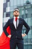 Businessman in a superman costume. Stock Photos