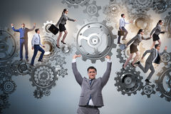 The businessman supporting gear in teamwork concept Royalty Free Stock Photos